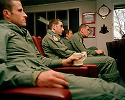 Pilot members of the 'Red Arrows', Britain's Royal Air Force aerobatic team in post-training flight briefing during winter training.