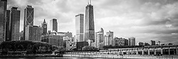 Chicago skyline panorama black and white photo with the John Hancock building and Lake Michigan shoreline along Streeterville. Panoramic photo ratio is 1:3. Image Copyright © Paul Velgos with All Rights Reserved.