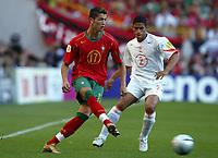 Fotball<br /> Euro 2004<br /> Portugal<br /> 30. juni 2004<br /> Foto: Dppi/Digitalsport<br /> NORWAY ONLY<br /> Semifinale<br /> Portugal v Nederland 2-1<br /> CRISTIANO RONALDO (POR) / MICHAEL REIZIGER (NET)