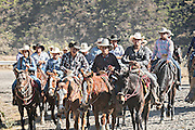 Hundreds of Mexican cowboys ride the road up Cubilete Mountain on the final leg of the annual Cabalgata de Cristo Rey pilgrimage January 5, 2017 in Silao, Guanajuato, Mexico. Thousands of Mexican cowboys and horse take part in the three-day ride to the mountaintop shrine of Cristo Rey.