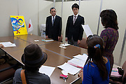 Yukie Tokura meets  officials from the Cabinet Office as organizers of the Anti nuclear protest by women outside the Ministry of Economy, Trade and Industry (METI) visit to present their demands. Tokyo Japan. Friday November 4th 2011. The protest ran from October 27th to Noverber 5th. Originally started my mothers from Fukushima protesting about nuclear contamination from October 30th to November 5th the protest welcomed women and people from all over Japan.