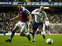 Photograph: Scott Heavey.<br />Tottenham Hotspur v Aston Villa. FA Barclaycard Premiership. 23/11/2003.<br />Steven Carr slips past Gareth Barry (L)