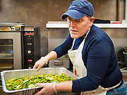"26 FEBRUARY 2020 - FARMINGTON, MINNESOTA: SCOTT EVENSON, a former professional chef, prepares the meal for the community dinner at Faith Church, a United Methodist Church in Farmington, MN, about 30 minutes south of the Twin Cities. The dinner is sponsored by Loaves & Fishes, a Christian organization that provides food for community dinners and foodbanks. Farmington, with a population of 21,000, is a farming community that has become a Twin Cities suburb. The city lost its only grocery store, a Family Fresh Market, in December, 2019. The closing turned the town into a ""food desert."" In January, Faith Church started serving the weekly meals as a response to the store's closing. About 125 people per week attend the meal at the church, which is just a few blocks from the closed grocery store. The USDA defines food deserts as having at least 33% or 500 people of a census tract's population in an urban area living 1 mile from a large grocery store or supermarket. Grocery chains Hy-Vee and Aldi both own land in Farmington but they have not said when they plan to build or open stores in the town.      PHOTO BY JACK KURTZ"