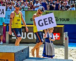 10-07-2011 VOLLEYBAL: FIVB WORLD TOUR BEACHVOLLEYBAL: GSTAAD<br /> (L-R) Jonas Reckermann, Julius Brink GER winnen de bronzen medaille<br /> ©2011-www.FotoHoogendoorn.nl / Peter Schalk