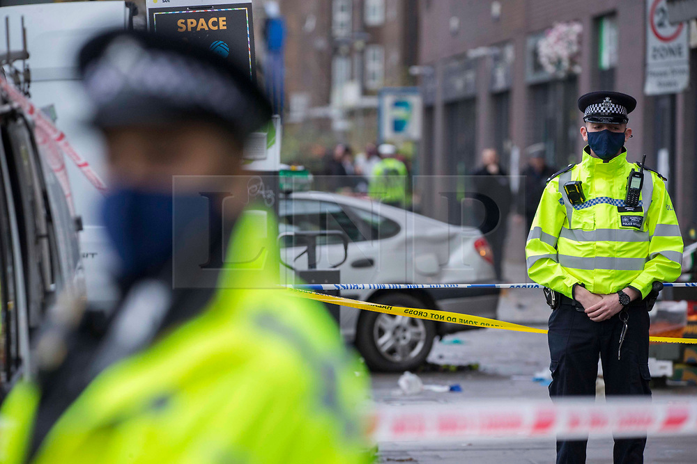 © Licensed to London News Pictures.11/12/2020. London, UK. Police guard a scene after a car has mounted the pavement and struck a number of pedestrians in Stamford Hill, north London. Photo credit: Marcin Nowak/LNP