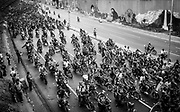 """Hundreds of motorbikes chase the official motorcade with Venezuela's President, Hugo Chávez, on a high-way of  Caracas on the 15th March, 2013. The coffin of Venezuela's President, Hugo Chávez, was translated from the Military Academy to the 4th February Military headquarters where it will stay until a final decision is made for the final place of his remains. Chávez ruled Venezuela for 14 years, passed away on the 5th March 2013.  He revolutionized not only his nation but also other countries in Latin America, with his political views and what he called the """"21st Century Socialism"""", supported by the petrodollars from Venezuela's massive oil-reserves."""