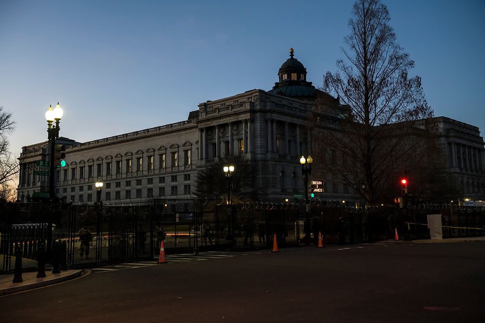 Washington DC, USA - January 19, 2021: The Thomas Jefferson Building, opened in 1897, is the oldest of the four United States Library of Congress buildings. Here it stands behind a recently built barrier, constructed after the January 6 attack on the Capitol Building by supporters of President Trump.