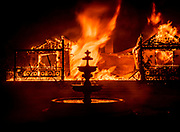 The Glass Mountain Inn on the Silverado Trail, burns near St. Helena in the Napa Valley on Sunday night, Sept. 27, 2020.