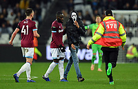 Football - 2018 / 2019 EFL Carabao (League) Cup - Fourth Round: West Ham United vs. Tottenham Hotspur<br /> <br /> A fan in a Scream mask invades the pitch, at the London Stadium<br /> <br /> COLORSPORT/ASHLEY WESTERN