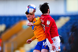 Stephen Quinn of Mansfield Town beats Aaron Wildig of Morecambe to get a head to the ball - Mandatory by-line: Ryan Crockett/JMP - 27/02/2021 - FOOTBALL - One Call Stadium - Mansfield, England - Mansfield Town v Morecambe - Sky Bet League Two
