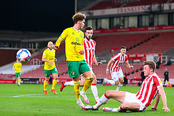 Josh Martin of Norwich City has his run halted by Harry Souttar of Stoke City  - Mandatory by-line: Nick Browning/JMP - 24/11/2020 - FOOTBALL - Bet365 Stadium - Stoke-on-Trent, England - Stoke City v Norwich City - Sky Bet Championship