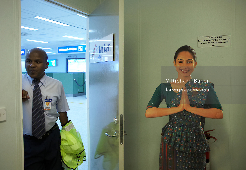 A Sri Lankan Airlines ground staff manager checks on the flight status of his next scheduled departure from Male, Maldives.