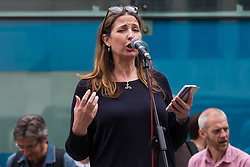 London, UK. 26th August, 2021. Ruth of Climate Emergency Centres addresses activists from Extinction Rebellion, Stop HS2, XR Roads Rebellion and Paid to Pollute outside the Department for Business, Energy and Industrial Strategy (BEIS) following the Stop The Harm march on the fourth day of Impossible Rebellion protests. Extinction Rebellion are calling on the UK government to cease all new fossil fuel investment with immediate effect.