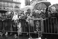 Citizens of Glasgow wait in the rain for a chance to see Nelson Mandela in Glasgow, Scotland, on 9th October 1993. Mandela was in Glasgow to receive the 'Freedom of the City' honour.