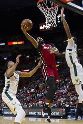 January 14, 2018 - Miami, FL, USA - Miami Heat forward James Johnson (16) scores in the first quarter against the Milwaukee Bucks on Sunday, Jan. 14, 2018 at the AmericanAirlines Arena in Miami, Fla. (Credit Image: © Matias J. Ocner/TNS via ZUMA Wire)