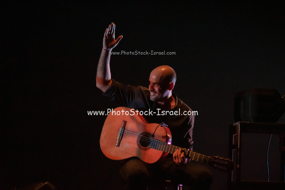 Traditional Spanish musician performing on stage