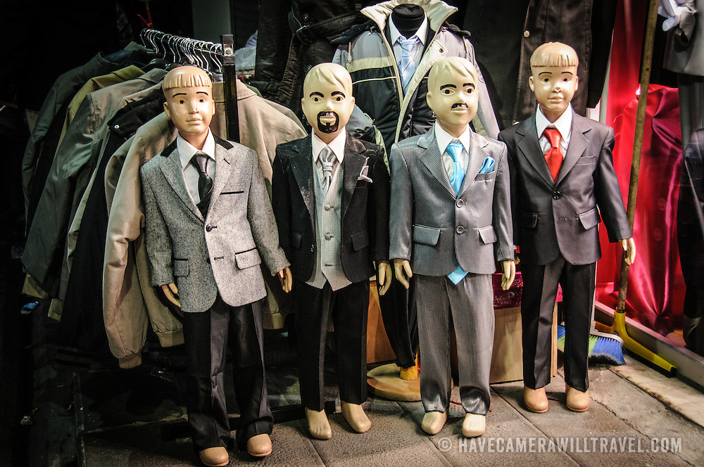 Child sized mannequins model small suits in a clothes store just outside the main complex of Istanbul's historic Grand Bazaar