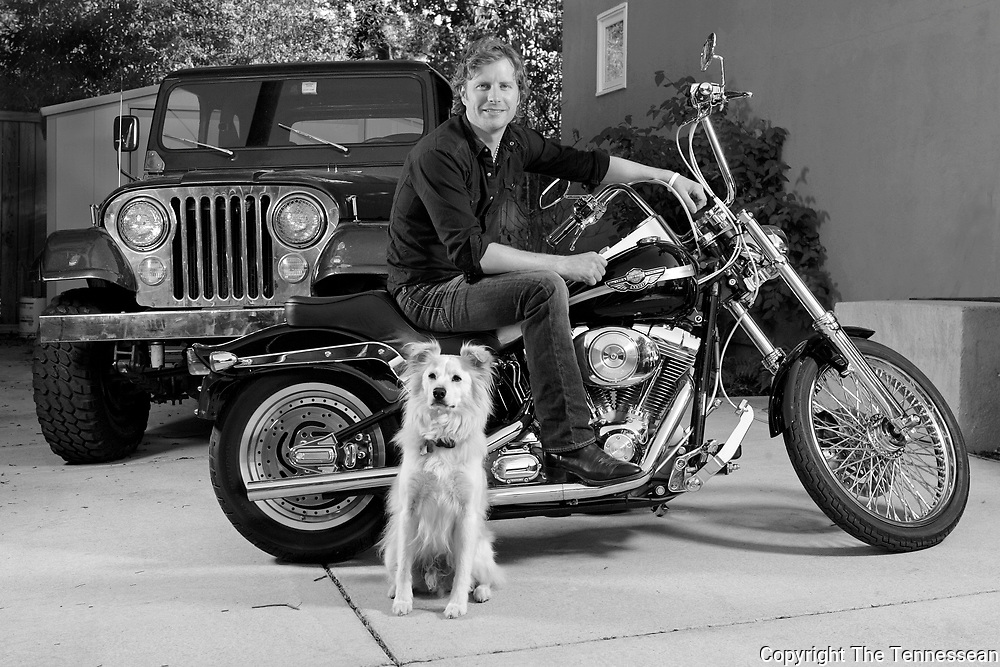Dierks Bentley sits on his Harley at his home in Nashville Thursday, September 25, 2008.