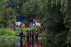 HS2 security guards and National Eviction Team enforcement agents monitor a HS2 Rebellion activist who had climbed a tree in Denham Country Park in order to try to protect it from works for the HS2 high-speed rail link on 8 September 2020 in Denham, United Kingdom. Anti-HS2 activists continue to try to prevent or delay works on the controversial £106bn project for which the construction phase was announced on 4th September from a series of protection camps based along the route of the line between London and Birmingham.