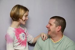 Father and daughter laughing together,