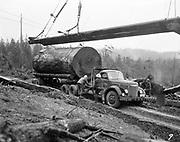 8602-D06.  Logging, log loading. A. A. Olson logging co., Port Angeles 1954.