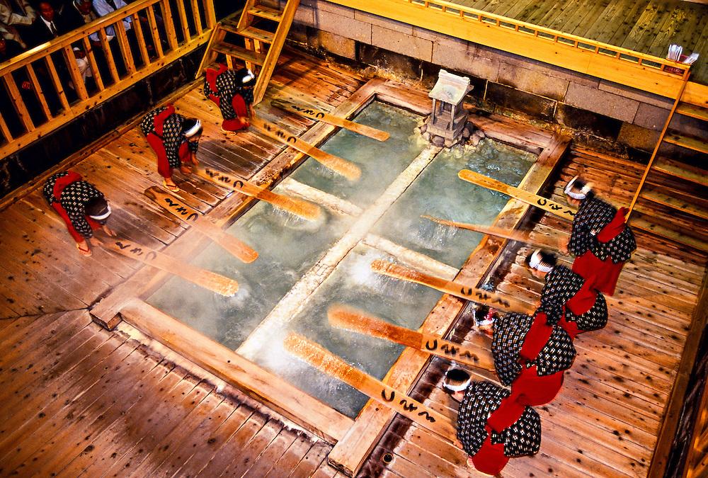 Yumomi (cooling hot bathwater), Kusatsu Onsen, Japan