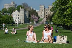 © licensed to London News Pictures. 19/04/2011.  Windsor, UK. Members of the public bathe in sunshine in Windsor, Berkshire as temperatures in the UK hit 25 degrees. Please see special instructions for usage rates. Photo credit should read Ben Cawthra/LNP