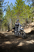 BMW R1200GS Adventure motorcycle running on dirt roads in mountains of central California