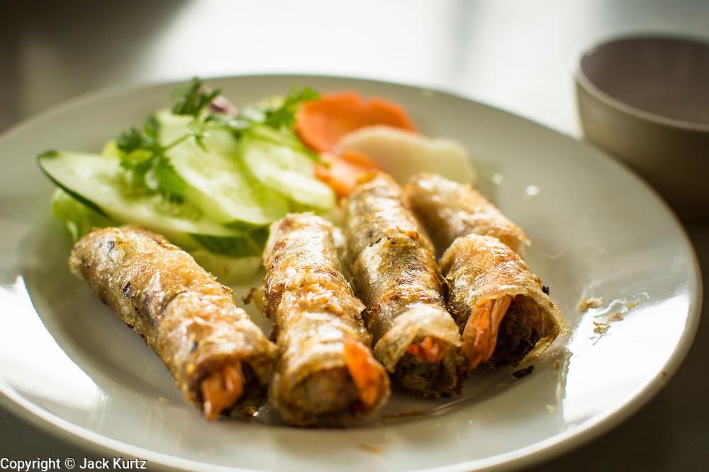 28 MARCH 2012 - HO CHI MINH CITY, VIETNAM: Shrimp spring rolls in a restaurant in Ho Chi Minh City (Saigon), Vietnam.    PHOTO BY JACK KURTZ