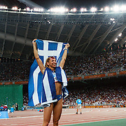 A panoramic view of Fani Halkia of Greece as she celebrates winning gold in the women's 400 meter hurdle final during the Athens 2004 Summer Olympic Games at the Olympic Stadium. Athens, Greece. 25th August 2004. Photo Tim Clayton.
