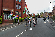 """Oldham, United Kingdom, June 21, 2021: Local communities along with their men, women and children are gathered to protest outside """"CAIRO House"""" in Oldham on Monday, June 21, 2021. Following the arrest of Palestine Action activists who scaled the roof of """"Cairo House"""" on Monday morning, people are demanding an immediate shutdown of Elbit subsidiaries in Britain. This is the ongoing protest forms of the human rights activists group in the UK targeting Israeli owned weapons manufacturer Elbit Systems. Activists argue that arms being manufactured in the facility are being used in indiscriminate attacks against the Gaza Strip. (VX Photo/ Vudi Xhymshiti)"""