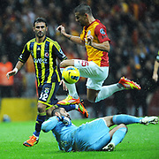 Galatasaray's Milan Baros (C) and Fenerbahce's Selcuk Sahin (L) during their Turkish superleague soccer derby match Galatasaray between Fenerbahce at the TT Arena in Istanbul Turkey on Friday, 18 March 2011. Photo by TURKPIX