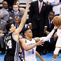 08 May 2016: Oklahoma City Thunder guard Russell Westbrook (0) goes for the layup past San Antonio Spurs guard Danny Green (14) during the Oklahoma City Thunder 111-97 victory over the San Antonio Spurs, during Game Four of the Western Conference Semifinals of the NBA Playoffs at the Chesapeake Energy Arena, Oklahoma City, Oklahoma, USA.