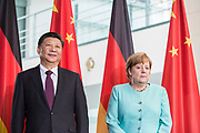 German Chancellor Angela Merkel and the Chinese President  Xi Jinping wait as German and Chinese counterparts sign and exchange mutual agreement,  prior to a Joint press conference in the Chancellery in Berlin, on July 5 2017.<br /> (Photo by Omer Messinger)