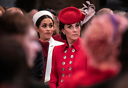 The Duchess of Cambridge (right) with the Duchess of Sussex (left) as they attend the Commonwealth Service at Westminster Abbey, London.