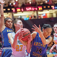 St. Pius X Sartan Arianna Martinez (23), left, and Kirtland Central Bronco Shayonna Begay (14) tie up in a District 5A quarterfinal at The Pit in Albuquerque Tuesday.