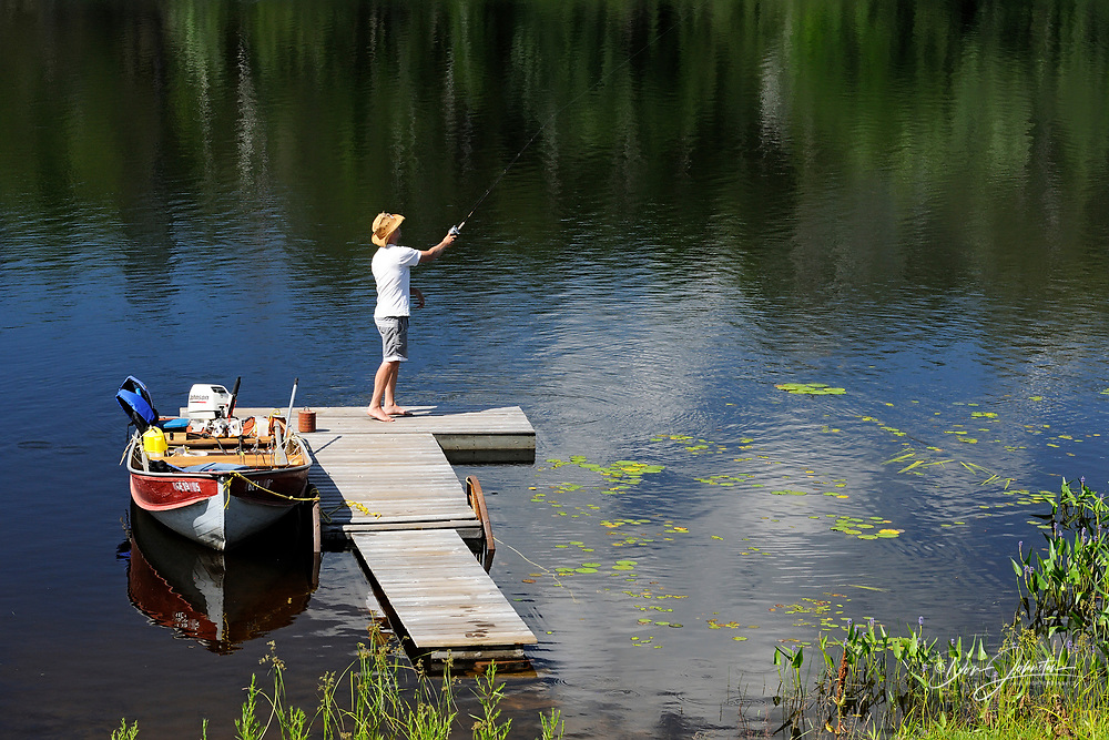 Still fishing from a dock in Elbow Lake, Wanup, Ontario, Canada