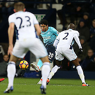 Jefferson Montero of Swansea city looks to play the ball past Allan Nyom of West Bromwich Albion. Premier league match, West Bromwich Albion v Swansea city at the Hawthorns stadium in West Bromwich, Midlands on Wednesday 14th December 2016. pic by Andrew Orchard, Andrew Orchard sports photography.