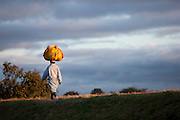 A man walking with a large package on his head in the captial city Antananarivo, Madagascar