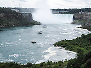 Niagara Falls, Canadian Side. Maid of the Mist tour boat approaches the Falls