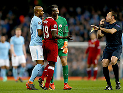 Match referee Antonio Miguel Mateu Lahoz (right) blows his whistle as Liverpool's Sadio Mane (second left), Manchester City's Fernandinho (left) and Manchester City goalkeeper Ederson (obscured) look on during the UEFA Champions League, Quarter Final at the Etihad Stadium, Manchester.