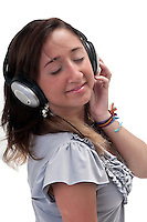 Young latin girl listening music very happy and cheerful.