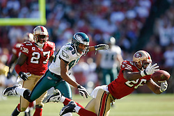 12 Oct 2008: Philadelphia Eagles wide receiver Greg Lewis #83 watches as San Francisco 49ers FS Mark Roman #26 nearly intercepts a pass during the game against the San Francisco 49ers on October 12th, 2008. The Eagles won 40-26 at Candlestick Park in San Francisco, California. (Photo by Brian Garfinkel) (Photo by Brian Garfinkel)