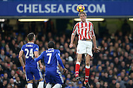 Peter Crouch of Stoke City jumps to head the ball.  Premier league match, Chelsea v Stoke city at Stamford Bridge in London on Saturday 31st December 2016.<br /> pic by John Patrick Fletcher, Andrew Orchard sports photography.