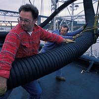 USA, Alaska, First mate Ken Grieg on bridge of Arco Juneau oil tanker at sunset