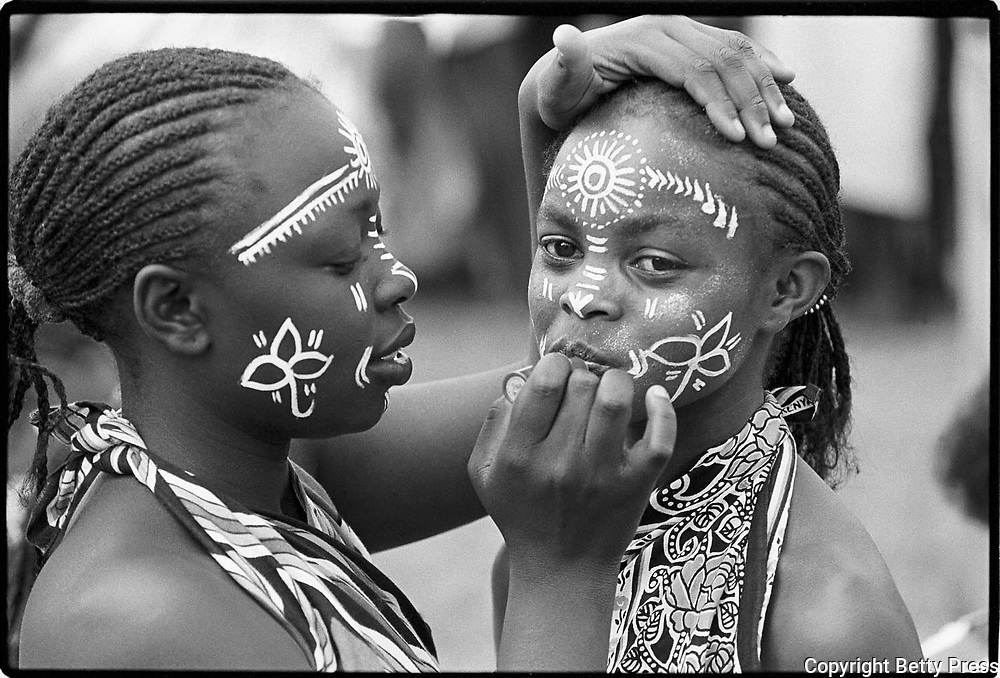 She who spends time adorning herself knows she is going to dance.  Kenyan proverb<br /> <br /> Young dancers make up their faces in preparation for a dance. Many schools have extracurricular activities encouraging music, dance, and drama.  Nairobi, Kenya  1990