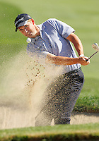 24 February 2006: PGA golfer Padraig Harrington (IRE) chips the golf ball  out of a greenside bunker on the 7th hole on during day three of the 2006 World Golf Championships Accenture Match Play Championships in Carlsbad, CA.