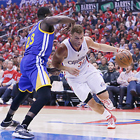 21 April 2014: Los Angeles Clippers forward Blake Griffin (32) drives past Golden State Warriors forward Draymond Green (23) during the Los Angeles Clippers 138-98 victory over the Golden State Warriors, during Game Two of the Western Conference Quarterfinals of the NBA Playoffs, at the Staples Center, Los Angeles, California, USA.