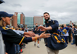 Sep 8, 2018; Morgantown, WV, USA; West Virginia Mountaineers quarterback Will Grier (7) arrives at the stadium before their game against the Youngstown State Penguins at Mountaineer Field at Milan Puskar Stadium. Mandatory Credit: Ben Queen-USA TODAY Sports