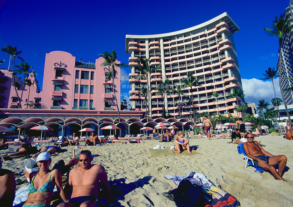 Image of Waikiki Beach on a sunny day with people on the beach and nearby resorts, Honolulu, Oahu, Hawaii by Andrea Wells